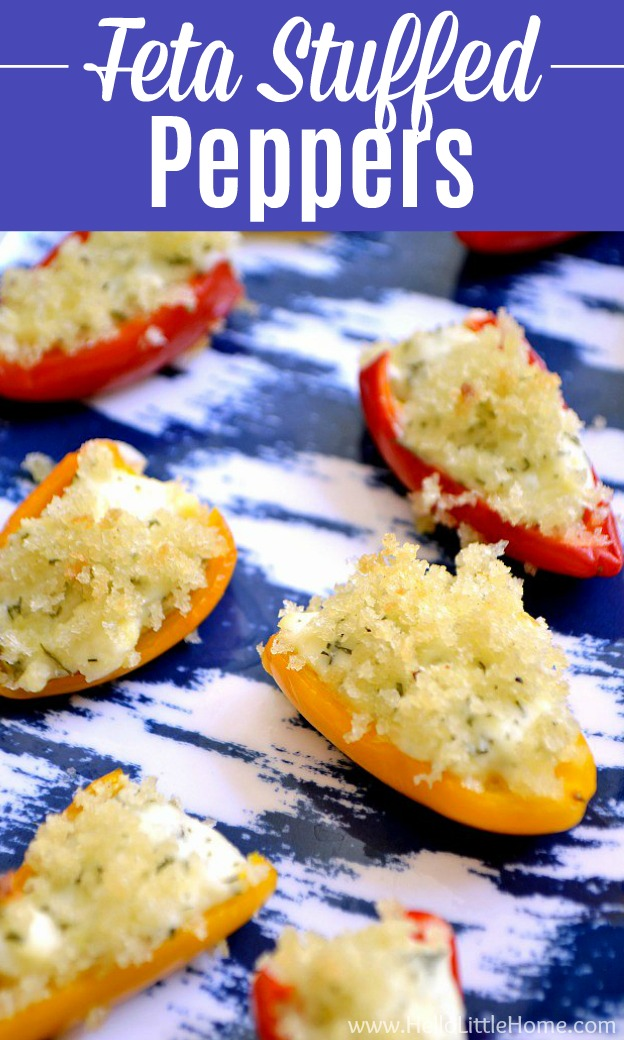 A blue patterned tray topped with Feta Stuffed Peppers.