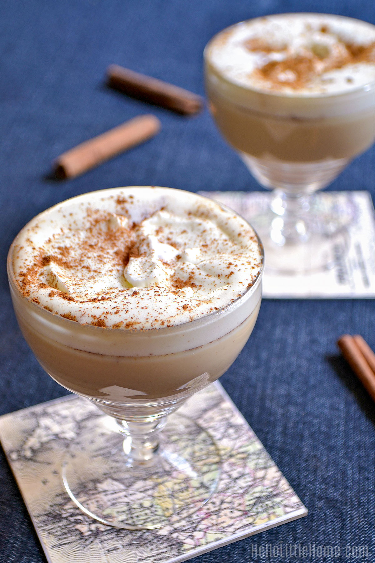 Two Pumpkin Spice Crème drinks on a blue tablecloth.