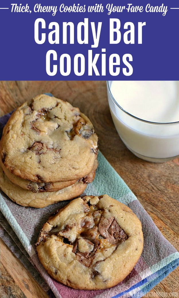 A stack of candy bar cookies with a glass of milk.
