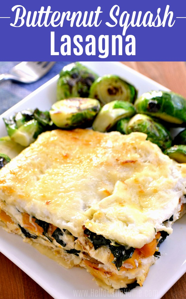 A big piece of Butternut Squash Lasagna on a plate with brussels sprouts.