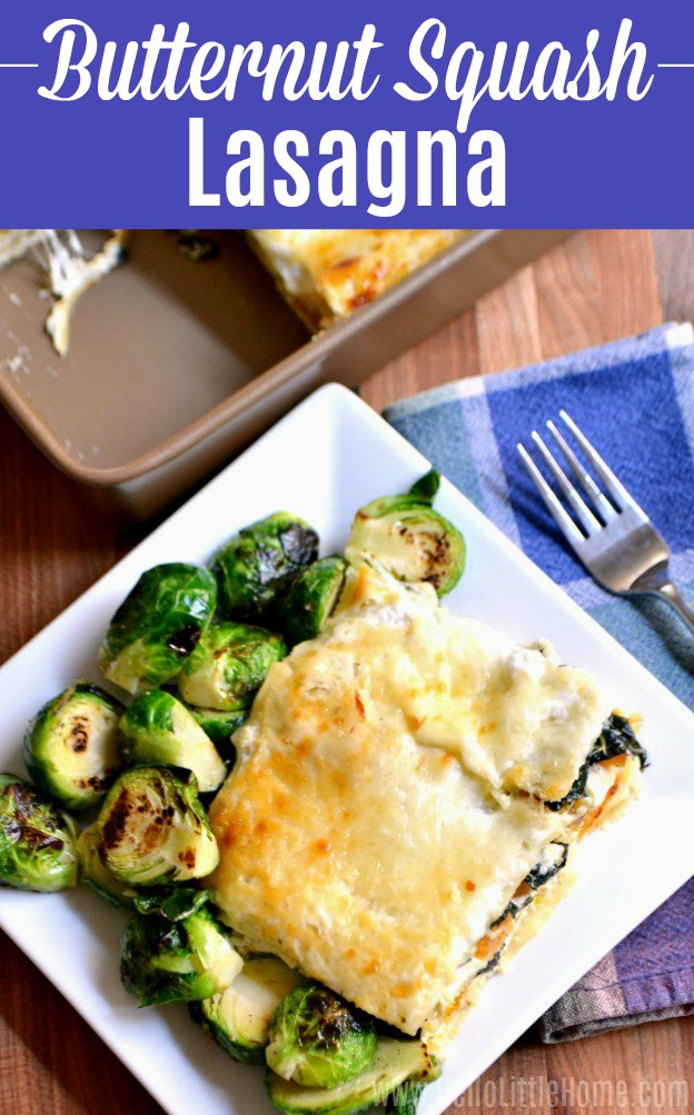A piece of Butternut Squash Lasagna served with roasted brussels sprouts.