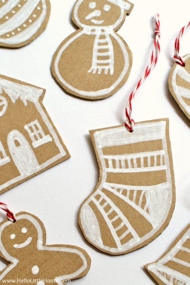 DIY Cardboard Gingerbread Ornaments ... make your own Christmas ornaments with this fun, easy, and CHEAP tutorial! These DIY Christmas ornaments are a great holiday craft for kids and for adults that's made from paper. Use these simple DIY Christmas ornaments for your tree, for gift decorating, or give them as a holiday present! | Hello Little Home