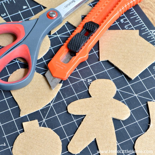 Cutting out the DIY Cardboard Gingerbread Ornaments | Hello Little Home
