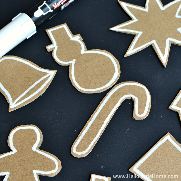 Outlining the DIY Gingerbread Ornaments with a Marker | Hello Little Home