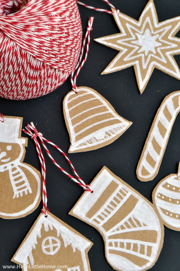 DIY Cardboard Gingerbread Ornaments ... make your own Christmas ornaments with this fun, easy, and CHEAP tutorial! Use them to decorate your tree, dress up a gift, or give them as a holiday present! | Hello Little Home