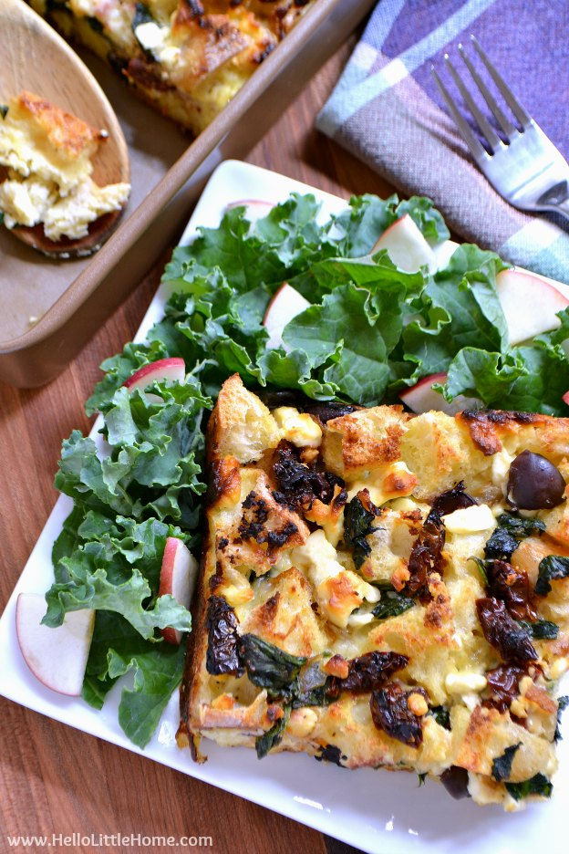 Mediterranean Strata with Olives, Sundried Tomatoes, and Feta ... Get this easy recipe + 100 other vegetarian winter recipes that are perfect for any occassion! | Hello Little Home
