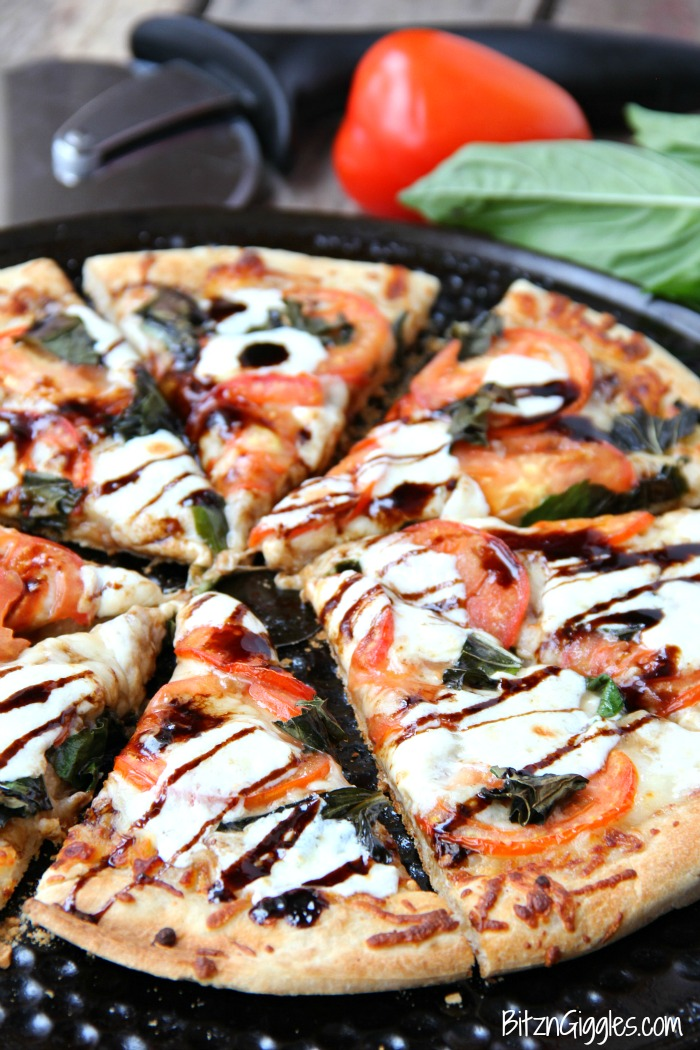 Caprese Pizza from Bitz and Giggles ... one of 100 Vegetarian Game Day Recipes! Get ready for the big game with over 100 vegetarian and vegan appetizers, soups, chilis, main dishes, sandwiches, breakfast, desserts, and more that will make your next football watching party unforgettable! | Hello Little Home