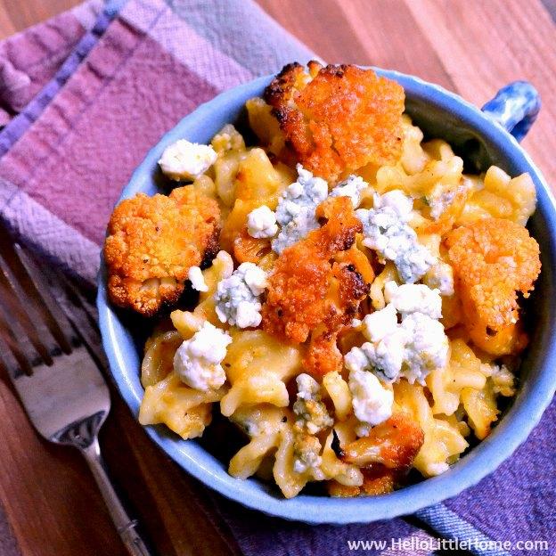A bowl of Buffalo Cauliflower Macaroni and Cheese on a plaid napkin.
