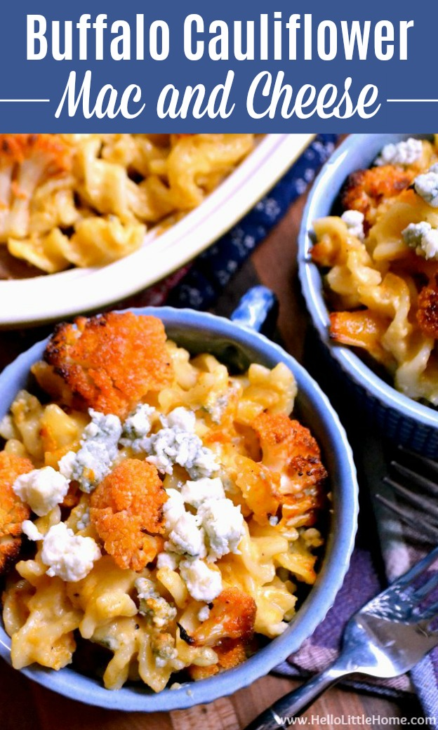 A pan and two bowls of Buffalo Cauliflower Mac and Cheese on a wood table.