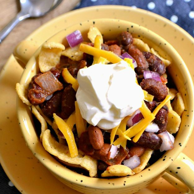 Overhead photo of the Frito Pie served in a large mug.