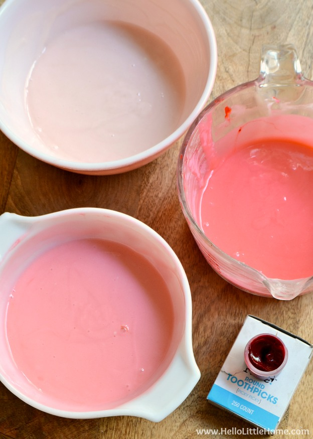 Coloring the cake batter with different shades of pink.