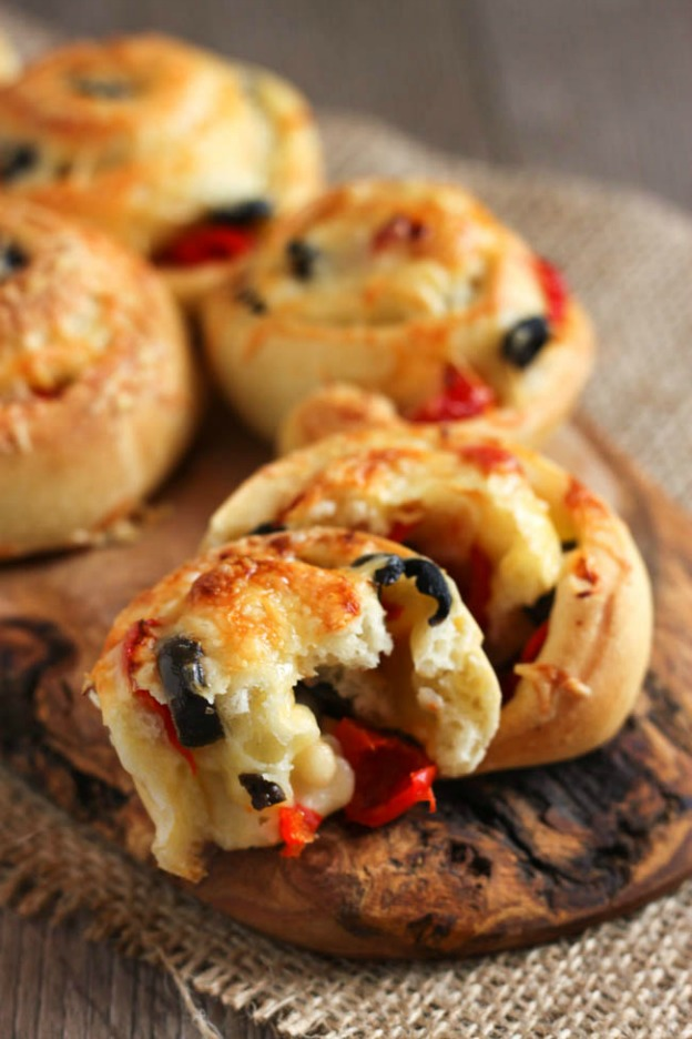 Black Olive and Peppadew Cheese Rolls from Amuse Your Bouche ... one of 100 Vegetarian Game Day Recipes! Get ready for the big game with over 100 vegetarian and vegan appetizers, soups, chilis, main dishes, sandwiches, breakfast, desserts, and more that will make your next football watching party unforgettable! | Hello Little Home