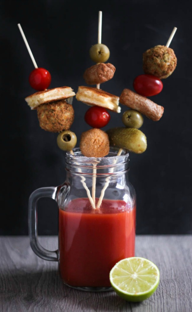 Vegetarian Loaded Bloody Mary from Amuse Your Bouche ... one of 100 Vegetarian Game Day Recipes! Get ready for the big game with over 100 vegetarian and vegan appetizers, soups, chilis, main dishes, sandwiches, breakfast, desserts, and more that will make your next football watching party unforgettable! | Hello Little Home