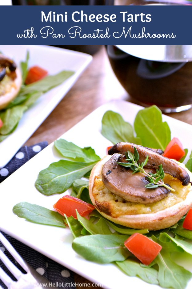 Mini Cheese Quiche with Pan Roasted Mushrooms served over arugula with red wine.