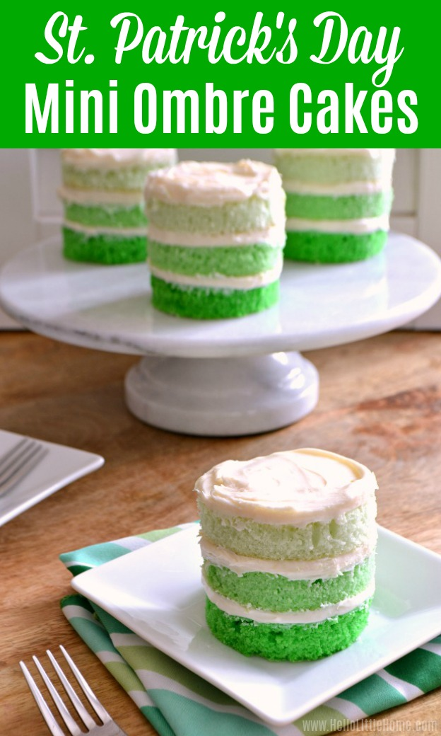 Three St. Patrick's Day Cakes on a marble cake stand with a green mini ombre cake in front.