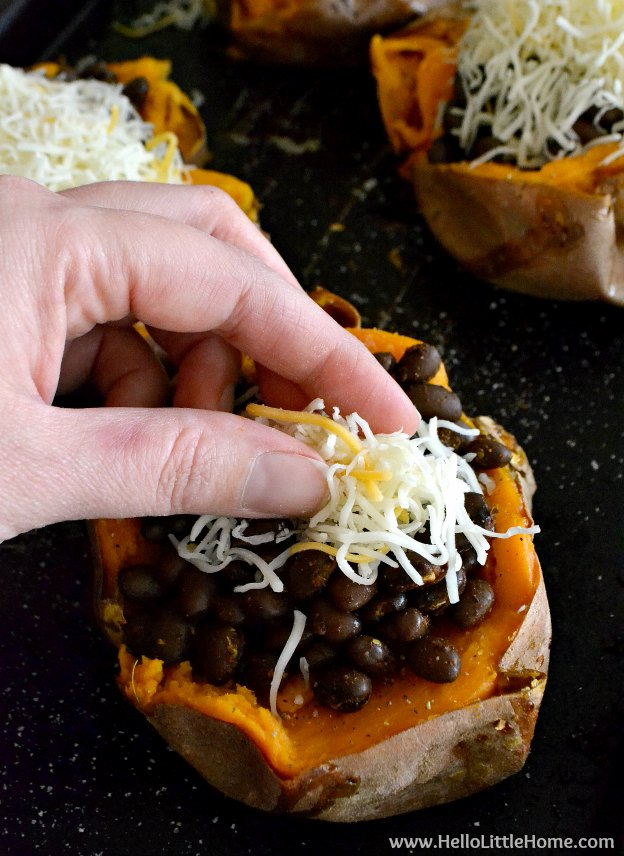 Stuffing sweet potatoes with beans and cheese.