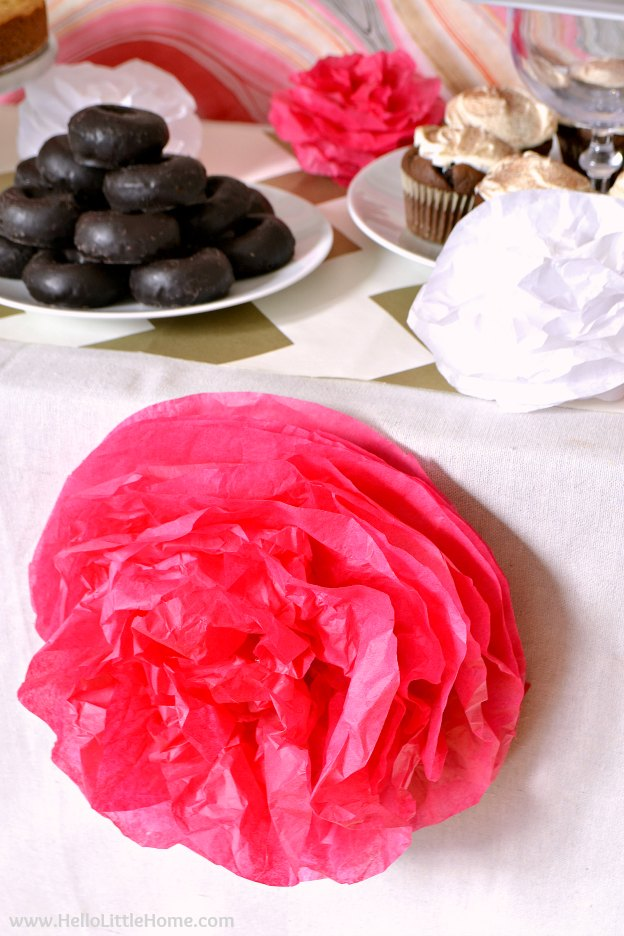 DIY Tissue Paper Pom Poms ... part of an easy Pink and Gold Birthday Party! Celebrate someone special with these fun, easy DIY birthday party decor ideas. This festive pink and gold party theme, featuring a marble backdrop, and a chocolate sweets tables, and more, is a cheery addition to any fiesta! | Hello Little Home