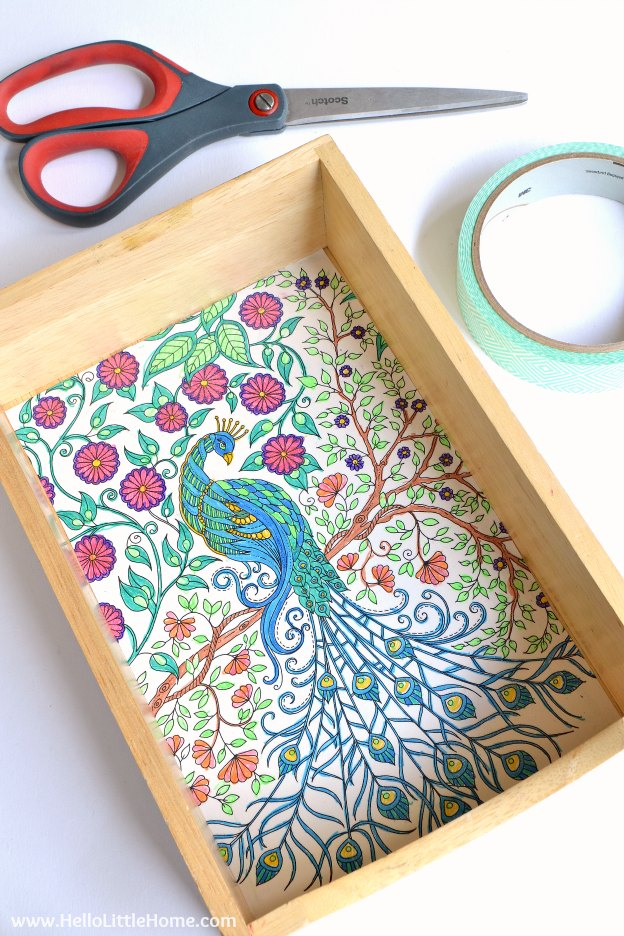 10 Easy Ways to Use Coloring Pages, like this lined tray! Love adult coloring books? Don't let your favorite pages sit unused! Try these easy DIY ideas for using completed pages ... from art to bows and more! | Hello Little Home