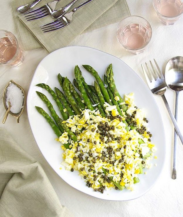 150+ Vegetarian Easter Recipes that are perfect for your holiday dinner or brunch, including this Asparagus with Grated Eggs and Capers from Pinch & Swirl! Find tons of vegetarian and vegan recipe ideas - from healthy appetizers to decadent desserts - that your whole family will love! Hello Little Home