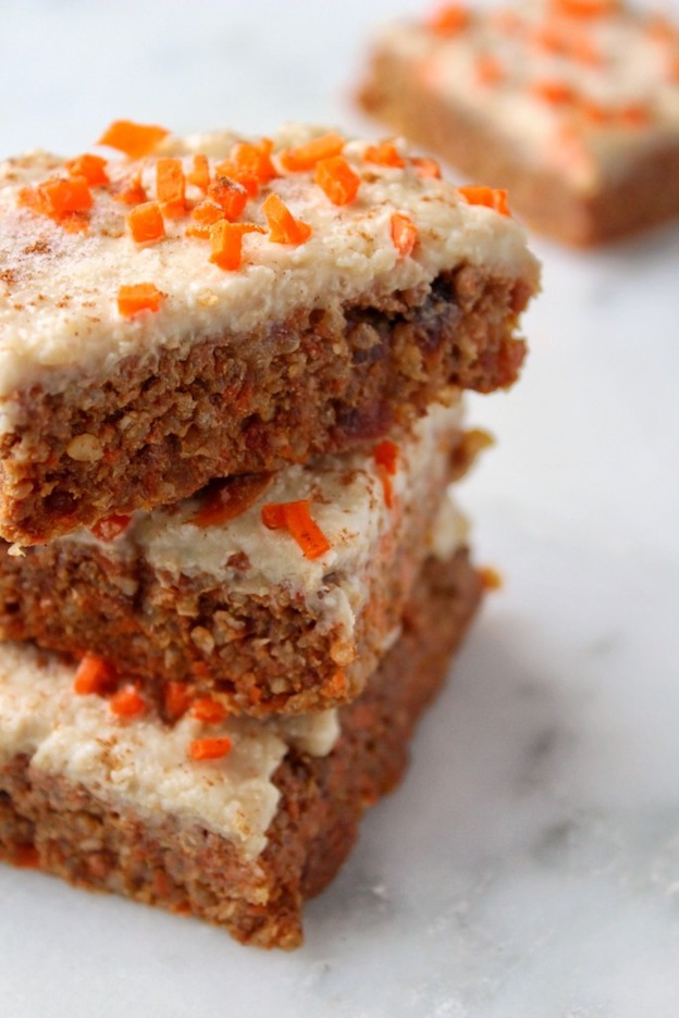 A stack of carrot cake bars on a marble counter.