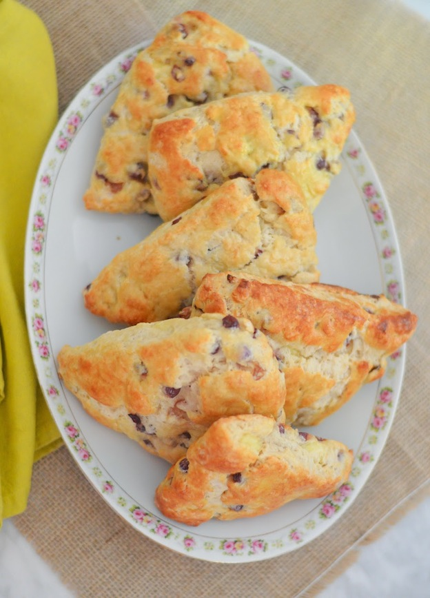 A floral pattered tray topped with scones.