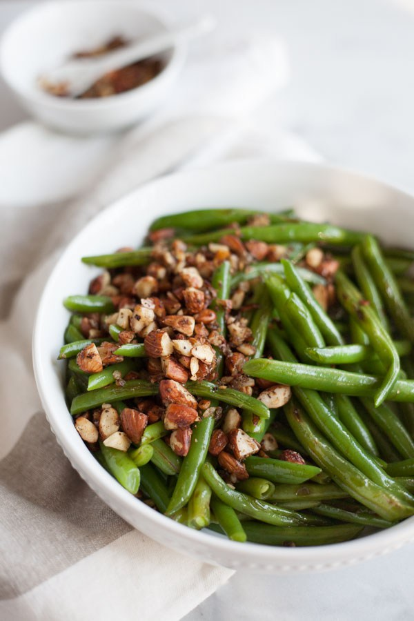 150+ Vegetarian Easter Recipes that are perfect for your holiday dinner or brunch, including these Green Beans with Almonds, Shallots, and Garlic from Bourbon & Honey! Find tons of vegetarian and vegan recipe ideas - from healthy appetizers to decadent desserts - that your whole family will love! Hello Little Home