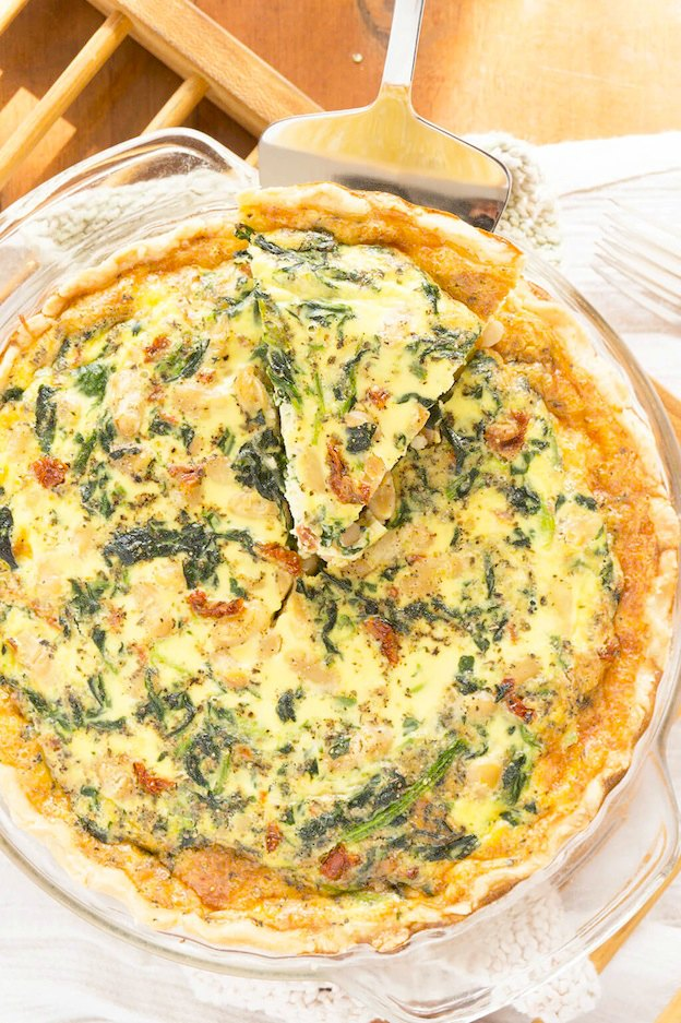 150+ Vegetarian Easter Recipes that are perfect for your holiday dinner or brunch, including this Spinach, White Bean, and Sundried Tomato Quiche from Oat & Sesame! Find tons of vegetarian and vegan recipe ideas - from healthy appetizers to decadent desserts - that your whole family will love! Hello Little Home