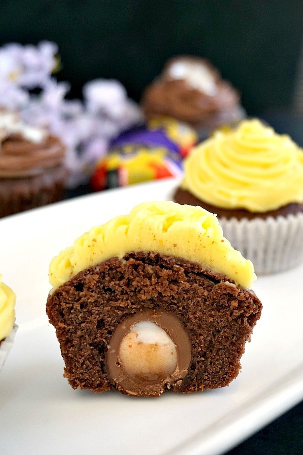 A halved cupcake on a white tray.