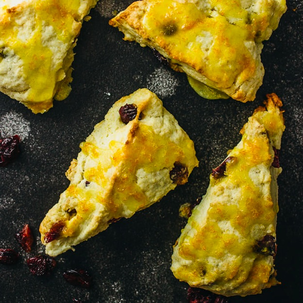 150+ Vegetarian Easter Recipes that are perfect for your holiday dinner or brunch, including these Cranberry Orange Scones from Savory Tooth! Find tons of vegetarian and vegan recipe ideas - from healthy appetizers to decadent desserts - that your whole family will love! Hello Little Home