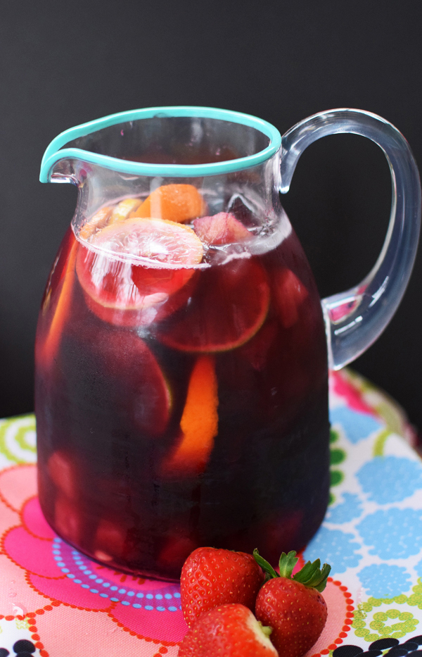 A pitcher of sangria on a colorful napkin.