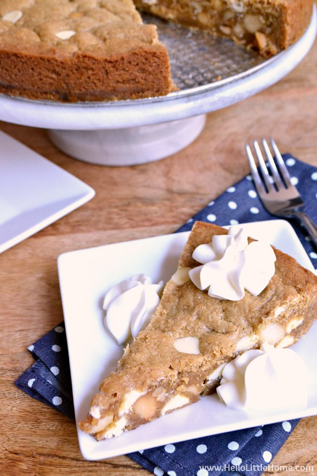 White Chocolate Macadamia Nut Cookie Cake ... the perfect treat for birthday parties or any special occasion! Learn how to make this easy homemade cookie cake recipe that's packed with sweet white chocolate chips and crunchy macadamia nuts. This decadent, oversized cookie pie is sure to become a favorite in your kitchen ... perfect for kids and adults alike!   Hello Little Home