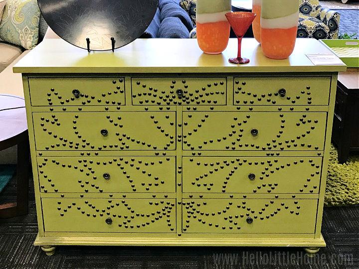 A bright green dresser in a budget furniture store.