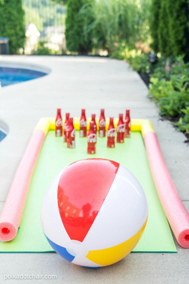 20+ DIY Yard Games that are perfect for summer entertaining, like this Beach Ball Bowling from Polka Dot Chair! These awesome lawn games for adults and kids - like cornhole, giant Jenga, Yardzee, tic tac toe + more - are perfect for backyards, camping trips, and family fun. Learn how to make DIY yard games from these easy tutorials, then enjoy these game all summer long! | Hello Little Home