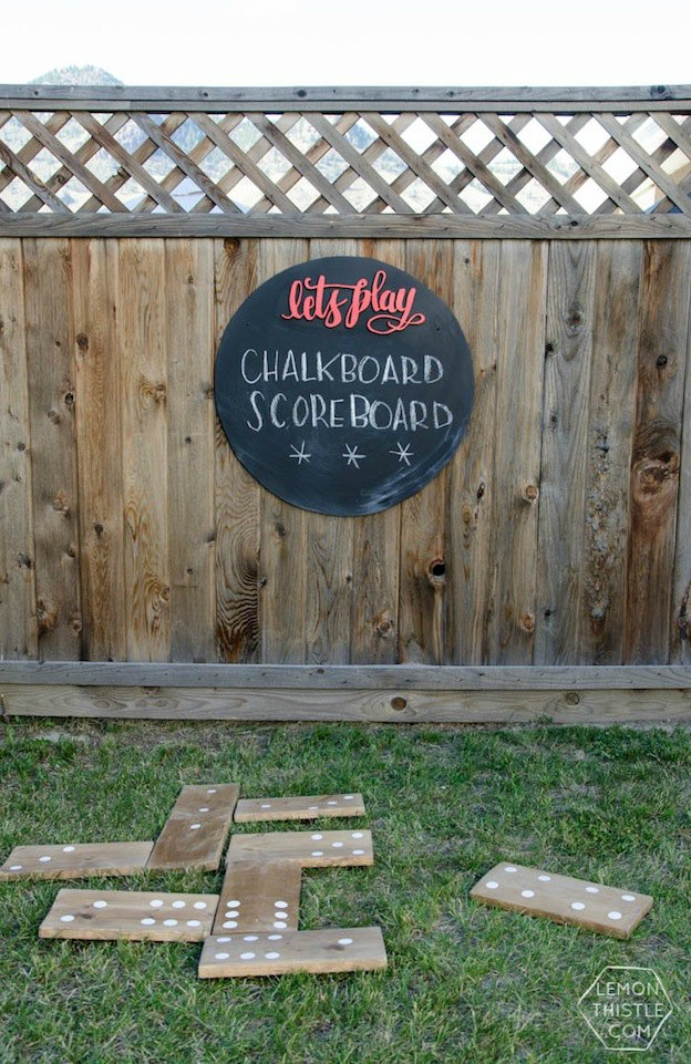 20+ DIY Yard Games that are perfect for summer entertaining, like this Giant Chalkboard Scoreboard from Lemon Thistle! These awesome lawn games for adults and kids - like cornhole, giant Jenga, Yardzee, tic tac toe + more - are perfect for backyards, camping trips, and family fun. Learn how to make DIY yard games from these easy tutorials, then enjoy these game all summer long! | Hello Little Home
