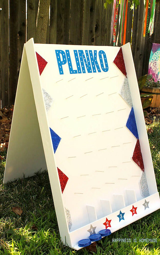 20+ DIY Yard Games that are perfect for summer entertaining, like this DIY Plinko Game from Happiness is Homemade! These awesome lawn games for adults and kids - like cornhole, giant Jenga, Yardzee, tic tac toe + more - are perfect for backyards, camping trips, and family fun. Learn how to make DIY yard games from these easy tutorials, then enjoy these game all summer long! | Hello Little Home