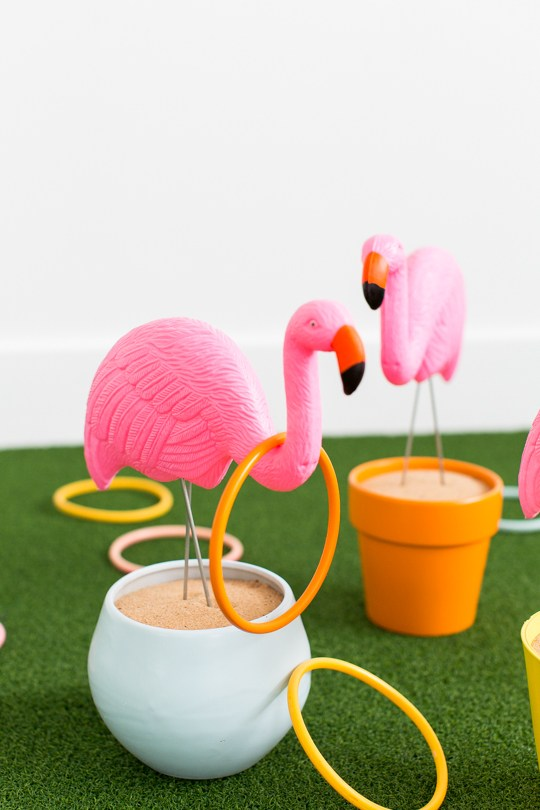 20+ DIY Yard Games that are perfect for summer entertaining, like this DIY Flamingo Ring Toss from Sugar & Cloth! These awesome lawn games for adults and kids - like cornhole, giant Jenga, Yardzee, tic tac toe + more - are perfect for backyards, camping trips, and family fun. Learn how to make DIY yard games from these easy tutorials, then enjoy these game all summer long! | Hello Little Home