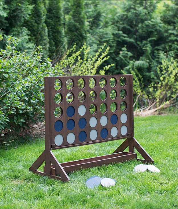 20+ DIY Yard Games that are perfect for summer entertaining, like this Giant Four in a Row from Build-Basic.com! These awesome lawn games for adults and kids - like cornhole, giant Jenga, Yardzee, tic tac toe + more - are perfect for backyards, camping trips, and family fun. Learn how to make DIY yard games from these easy tutorials, then enjoy these game all summer long! | Hello Little Home