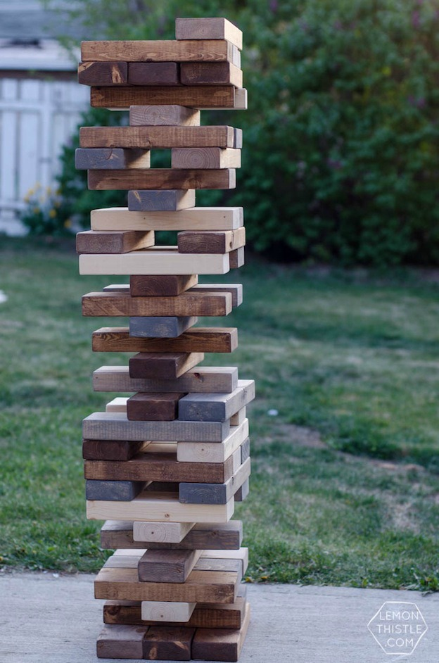 20+ DIY Yard Games that are perfect for summer entertaining, like this DIY Giant Jenga from Lemon Thistle! These awesome lawn games for adults and kids - like cornhole, giant Jenga, Yardzee, tic tac toe + more - are perfect for backyards, camping trips, and family fun. Learn how to make DIY yard games from these easy tutorials, then enjoy these game all summer long! | Hello Little Home