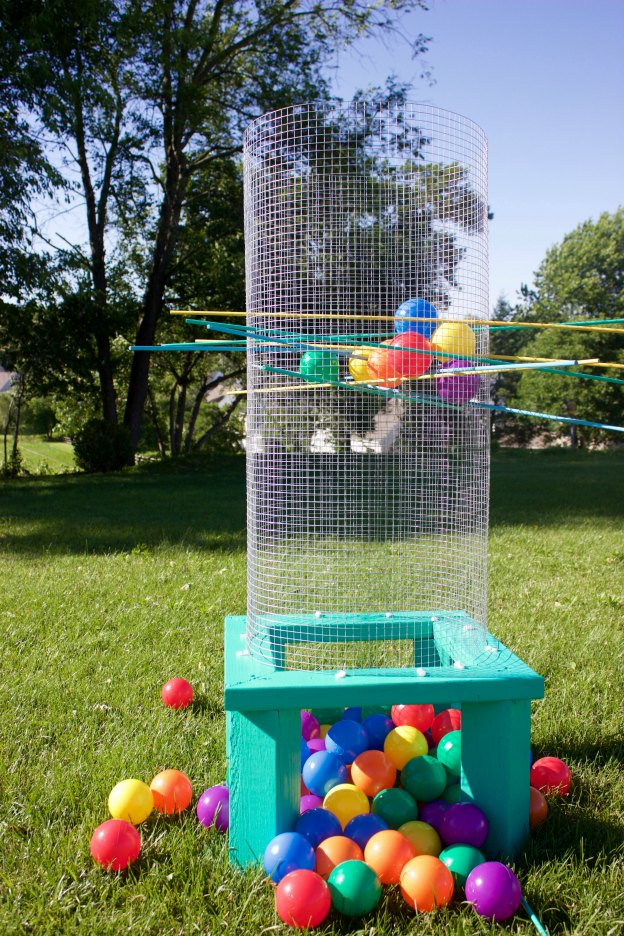 20+ DIY Yard Games that are perfect for summer entertaining, like this Giant Outdoor Kerplunk from A Little Craft in Your Day! These awesome lawn games for adults and kids - like cornhole, giant Jenga, Yardzee, tic tac toe + more - are perfect for backyards, camping trips, and family fun. Learn how to make DIY yard games from these easy tutorials, then enjoy these game all summer long! | Hello Little Home