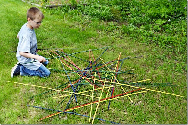 20+ DIY Yard Games that are perfect for summer entertaining, like this Giant Pick Up Sticks Game from Nellie Bellie! These awesome lawn games for adults and kids - like cornhole, giant Jenga, Yardzee, tic tac toe + more - are perfect for backyards, camping trips, and family fun. Learn how to make DIY yard games from these easy tutorials, then enjoy these game all summer long! | Hello Little Home