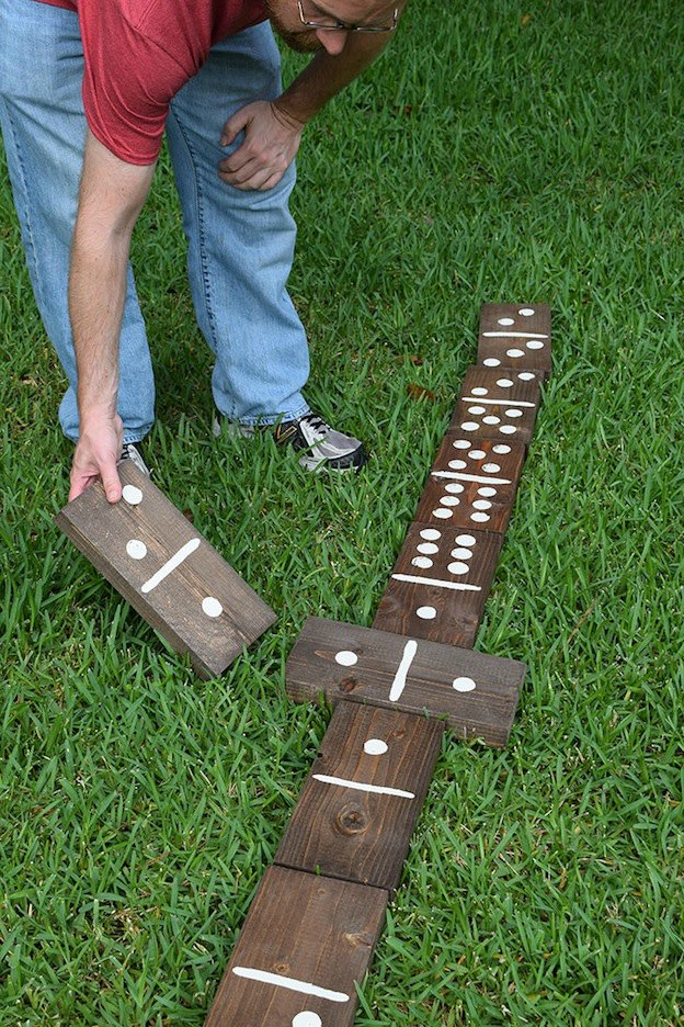 20+ DIY Yard Games that are perfect for summer entertaining, like these Giant Lawn Dominoes from Dream a Little Bigger! These awesome lawn games for adults and kids - like cornhole, giant Jenga, Yardzee, tic tac toe + more - are perfect for backyards, camping trips, and family fun. Learn how to make DIY yard games from these easy tutorials, then enjoy these game all summer long! | Hello Little Home