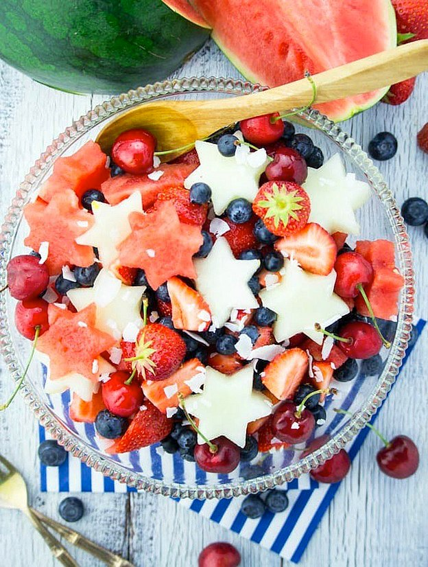 30 Amazing Red, White, and Blue Dessert Recipes, like this 4th of July Fruit Salad from Vegan Heaven, perfect for Fourth of July, Memorial Day, Labor Day, or any summer party! With everything from fruit salads to cheesecakes, these delicious patriotic dessert ideas run the gamut from healthy to decadent! | Hello Little Home