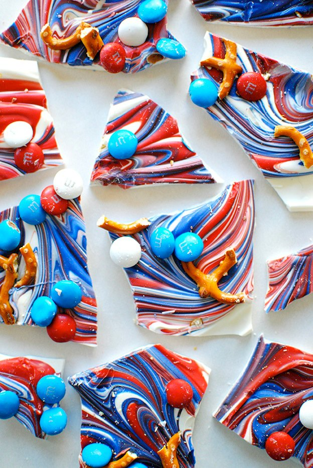 30 Amazing Red, White, and Blue Dessert Recipes, like this Red, White, and Blue Bark from Let's Eat Cake, perfect for Fourth of July, Memorial Day, Labor Day, or any summer party! With everything from fruit salads to cheesecakes, these delicious patriotic dessert ideas run the gamut from healthy to decadent! | Hello Little Home