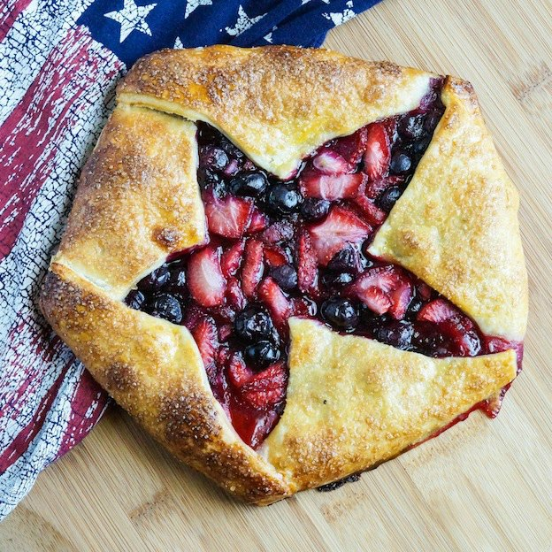 30 Amazing Red, White, and Blue Dessert Recipes, like this Star Galette from Tara's Multicultural Table, perfect for Fourth of July, Memorial Day, Labor Day, or any summer party! With everything from fruit salads to cheesecakes, these delicious patriotic dessert ideas run the gamut from healthy to decadent! | Hello Little Home