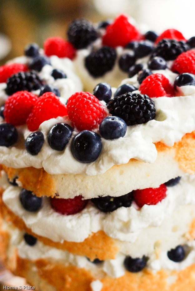 30 Amazing Red, White, and Blue Dessert Recipes, like this Angel Food Cake with Berries from Home & Plate, perfect for Fourth of July, Memorial Day, Labor Day, or any summer party! With everything from fruit salads to cheesecakes, these delicious patriotic dessert ideas run the gamut from healthy to decadent! | Hello Little Home