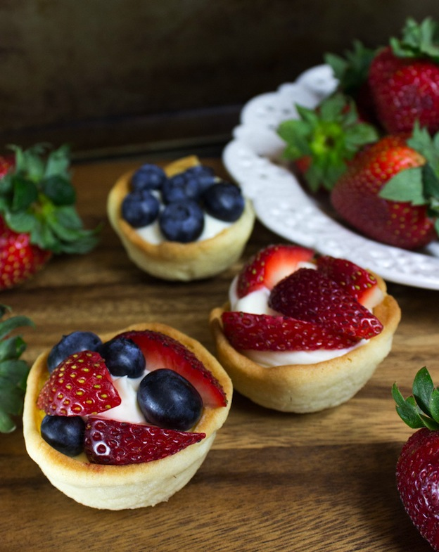 30 Amazing Red, White, and Blue Dessert Recipes, like these Cheesecake Bites from Sugar Spun Run, perfect for Fourth of July, Memorial Day, Labor Day, or any summer party! With everything from fruit salads to cheesecakes, these delicious patriotic dessert ideas run the gamut from healthy to decadent! | Hello Little Home