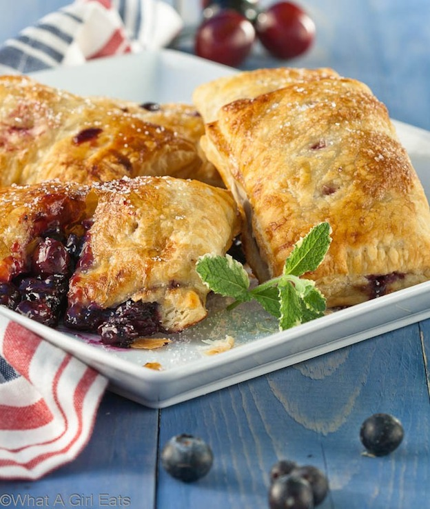 30 Amazing Red, White, and Blue Dessert Recipes, like these Fresh Fruit Hand Pies from What a Girl Eats, perfect for Fourth of July, Memorial Day, Labor Day, or any summer party! With everything from fruit salads to cheesecakes, these delicious patriotic dessert ideas run the gamut from healthy to decadent! | Hello Little Home