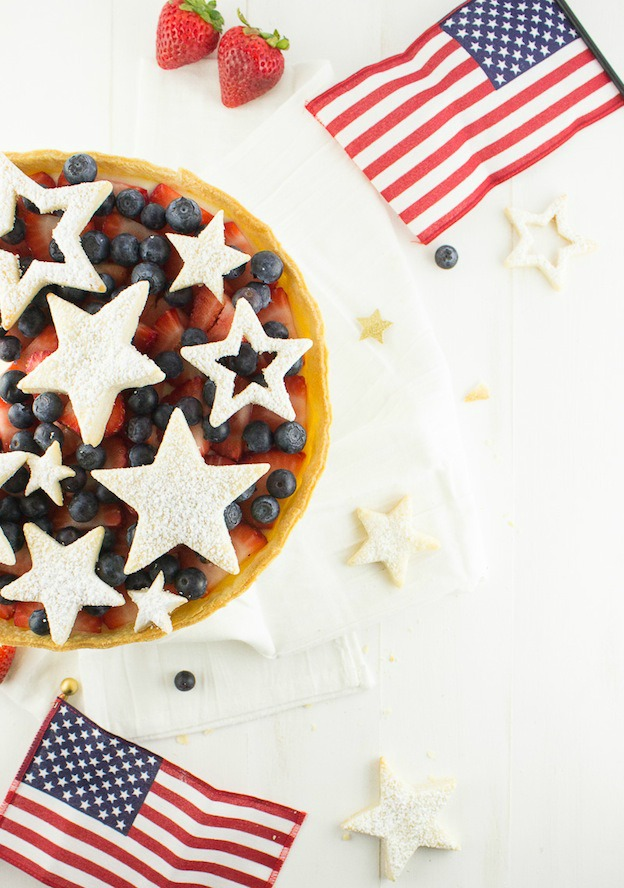 30 Amazing Red, White, and Blue Dessert Recipes, like this Red, White, and Blue Tart from The Sweet, Simple Life, perfect for Fourth of July, Memorial Day, Labor Day, or any summer party! With everything from fruit salads to cheesecakes, these delicious patriotic dessert ideas run the gamut from healthy to decadent! | Hello Little Home