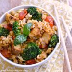 Spicy Tomato Basil Fried Rice ... a delicious, fast recipe idea that's perfect for busy weeknights! The best vegetarian fried rice recipe that's packed with tomatoes, broccoli, tofu, and fresh basil. Make it as spicy or mild as you prefer!   Hello Little Home