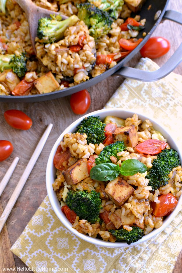 Spicy Tomato Basil Fried Rice ... a delicious, fast recipe idea that's perfect for busy weeknights! The best vegetarian fried rice recipe that's packed with tomatoes, broccoli, tofu, and fresh basil. Make it as spicy or mild as you prefer! | Hello Little Home